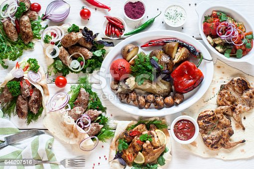 646207652istockphoto Buffet of tasty grilled meals flat lay 646207516