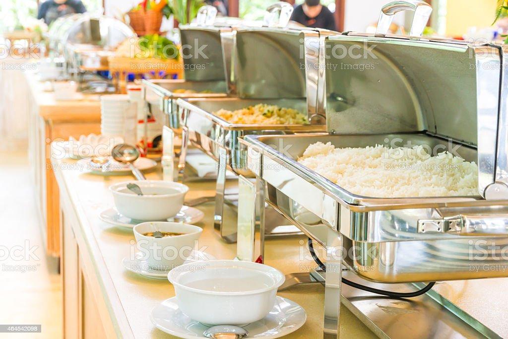 Buffet set on heated trays ready to eat. stock photo