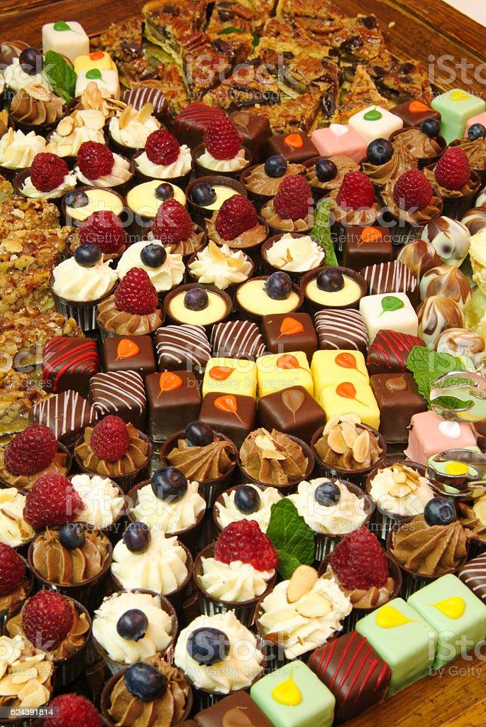 Buffet style finger dessert selection stock photo