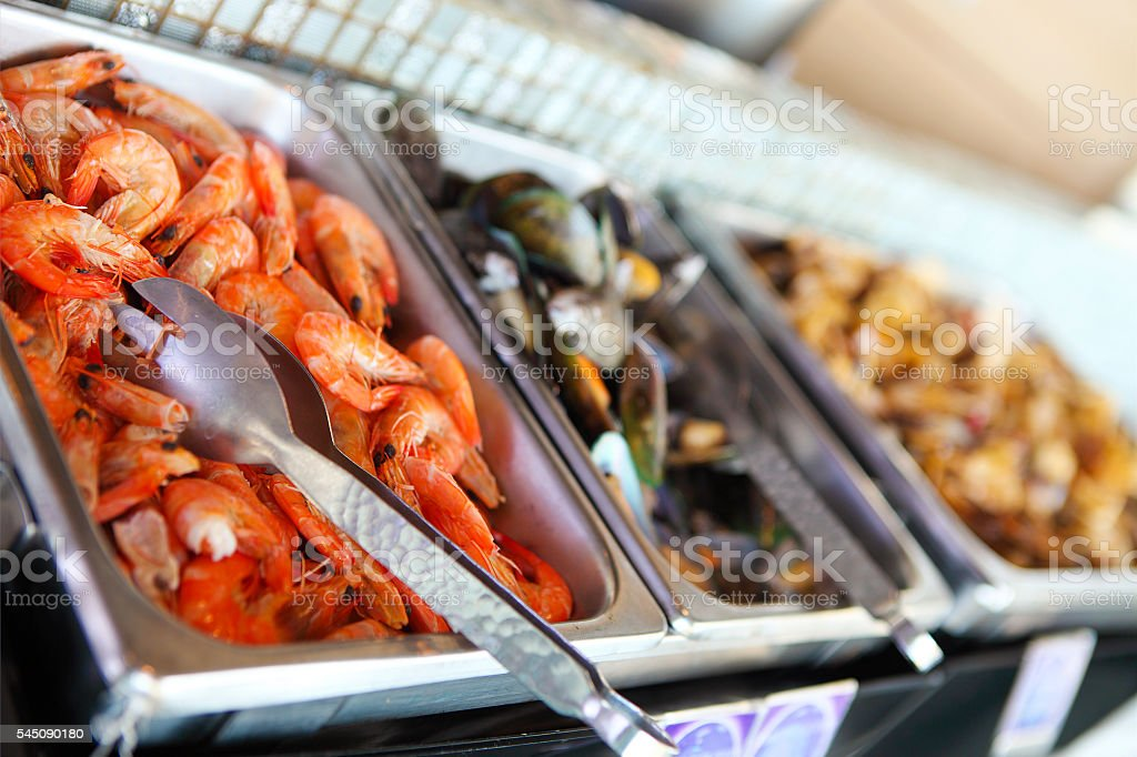 Buffet table with seafood, shrimps and  mussels stock photo