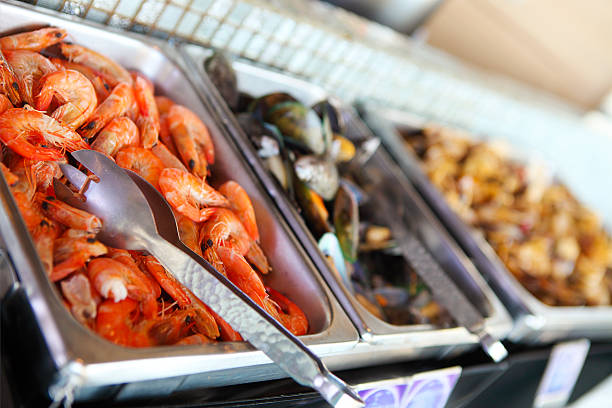Buffet table with seafood, shrimps and  mussels - foto de stock