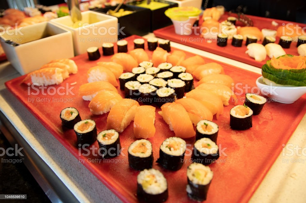 Buffett dinner. Foucus on Sushi  and fish specialties in buffett dinner at luxury hotel. Food concept. stock photo
