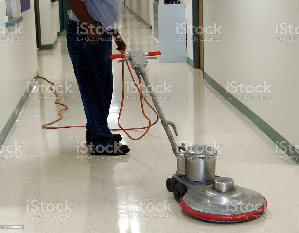 Buffing the floor royalty-free stock photo