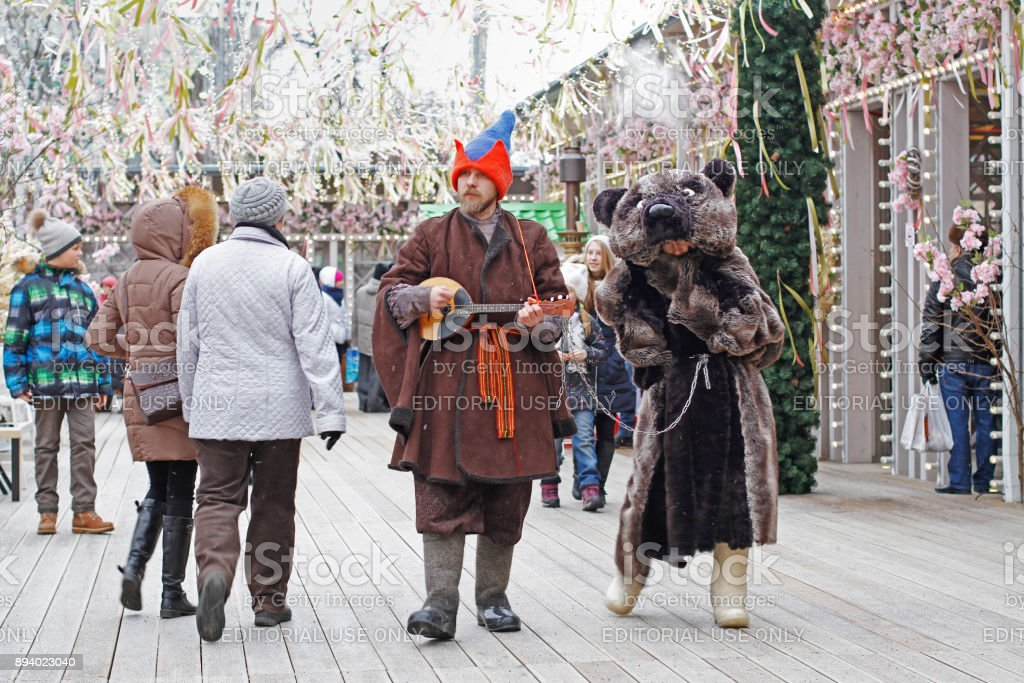 Buffoon with balalaika and bear at Russian national festival 'Shrove' on Tverskaya Square in Moscow stock photo