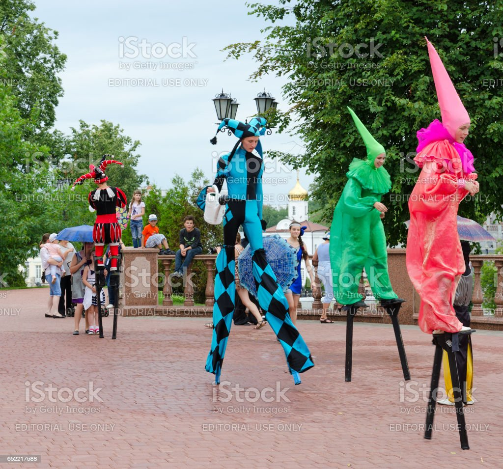 Buffoons on stilts during festival Slavic Bazaar, Vitebsk, Belarus stock photo