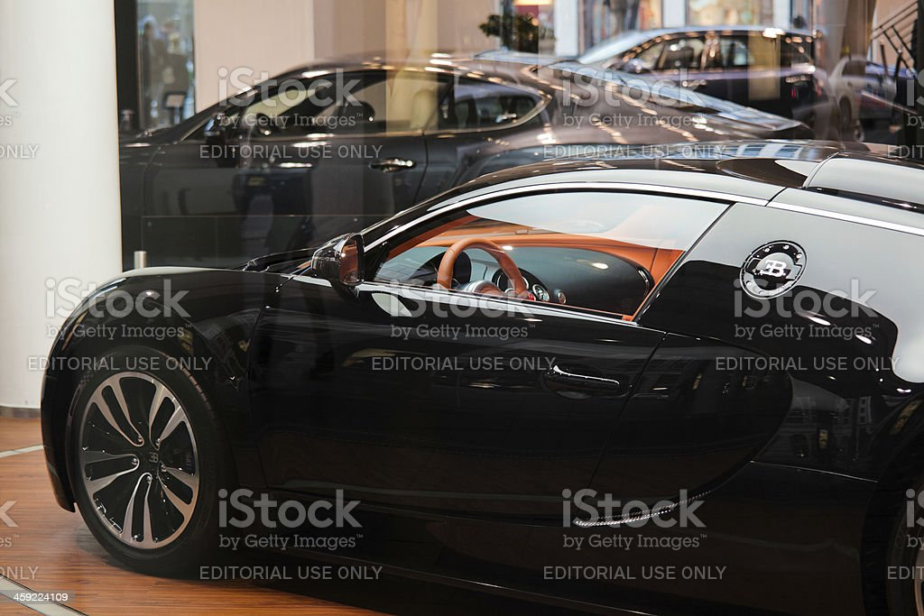 Bugatti Veyron and Luxurious Cars on a Showroom stock photo