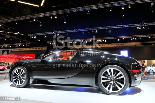 Amsterdam, The Netherlands - April 12, 2011: BlackBugatti Veyron Sang Noir supercar on display at the 2011 Amsterdam Motor Show. People are looking at the cars in the background. The 2011 Amsterdam motor show was running from April 12 until April 23, in the RAI event center in Amsterdam, The Netherlands.