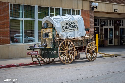 Deadwood, SD, USA - May 30, 2019: Horse drawn carriage information booth inside the gold rush historic place