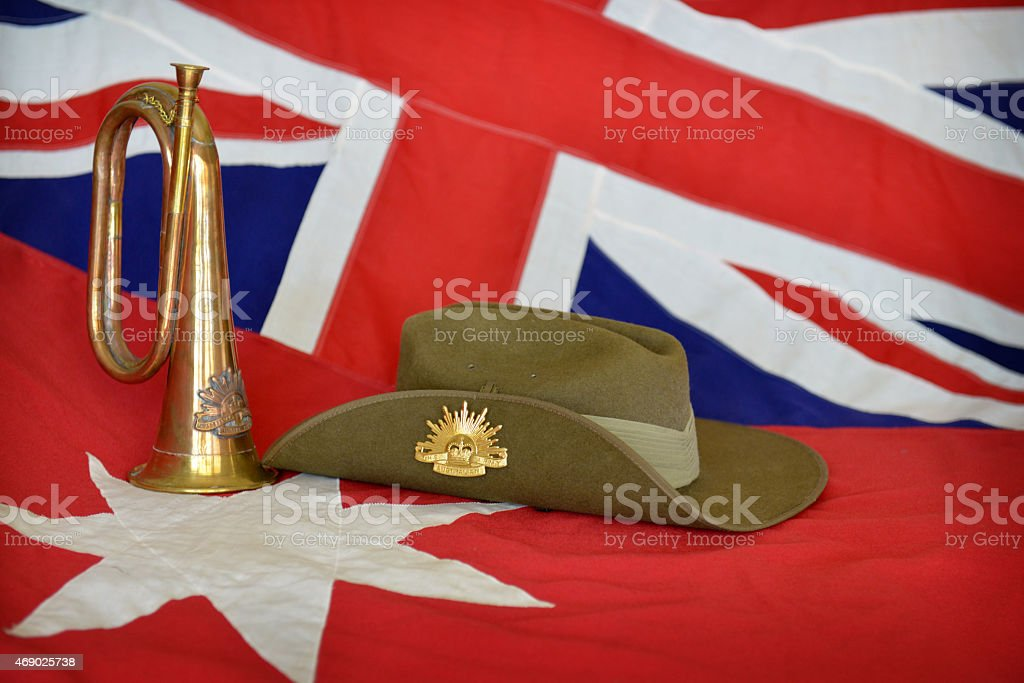 bugle and slouch hat on a red Australian flag stock photo