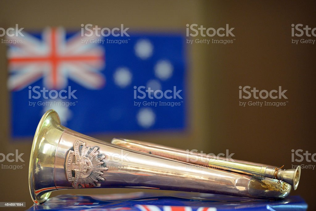 Bugle in front of an Australian flag stock photo