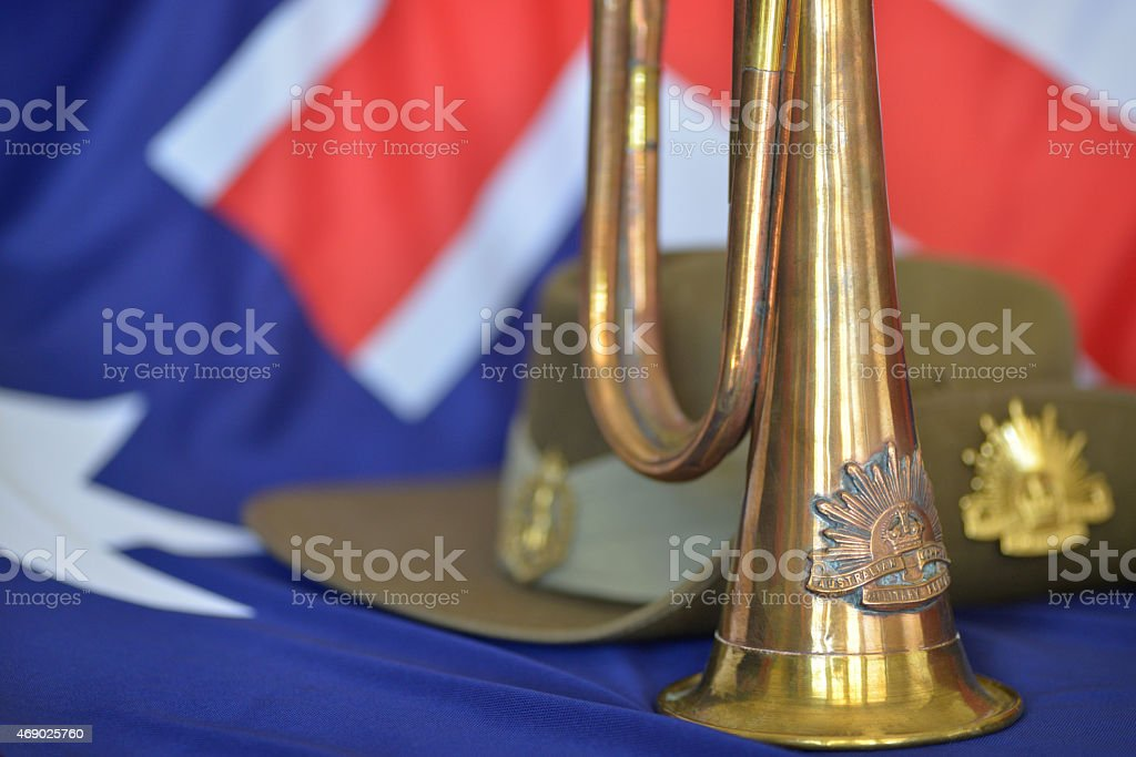 Bugle in front of slouch hat on an Australian flag stock photo