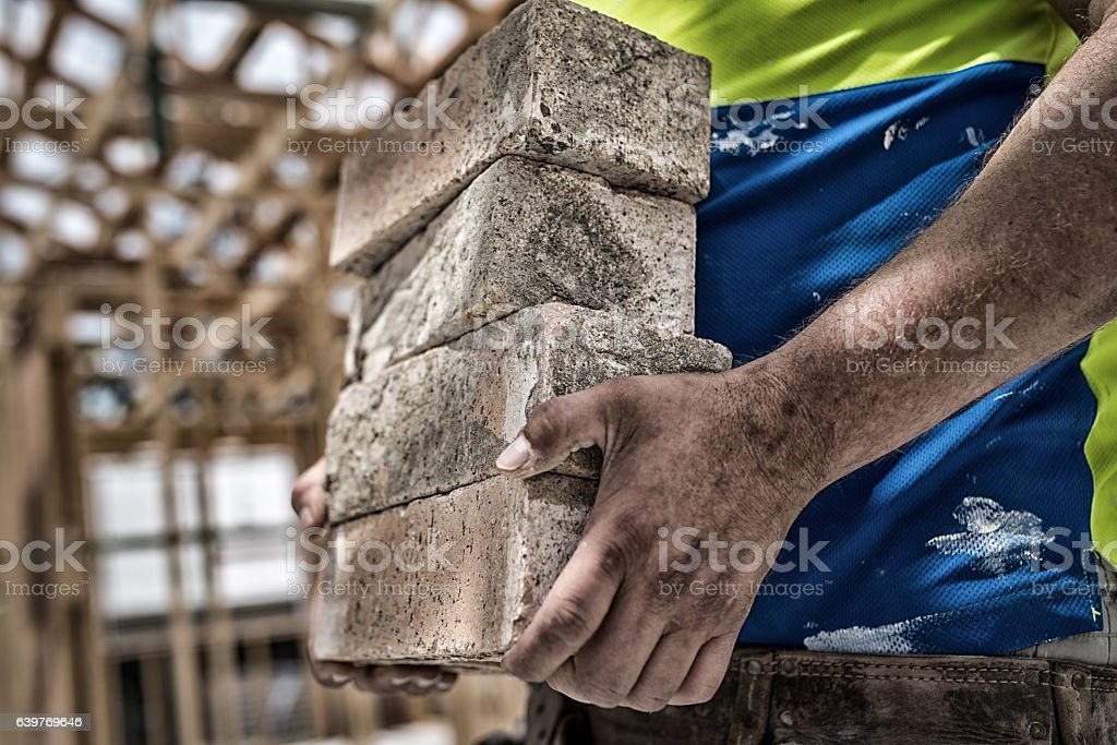 Buider with concrete blocks stock photo