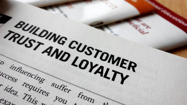 Buiding customer trust and loyalty word on a book stock photo