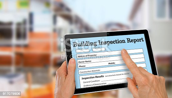 534196421istockphoto Buiding Inspector completing an inspection form on computer tablet 917079906