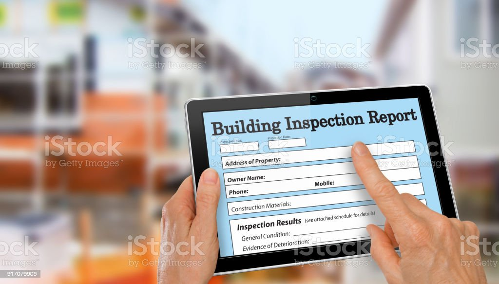 Buiding Inspector completing an inspection form on computer tablet stock photo