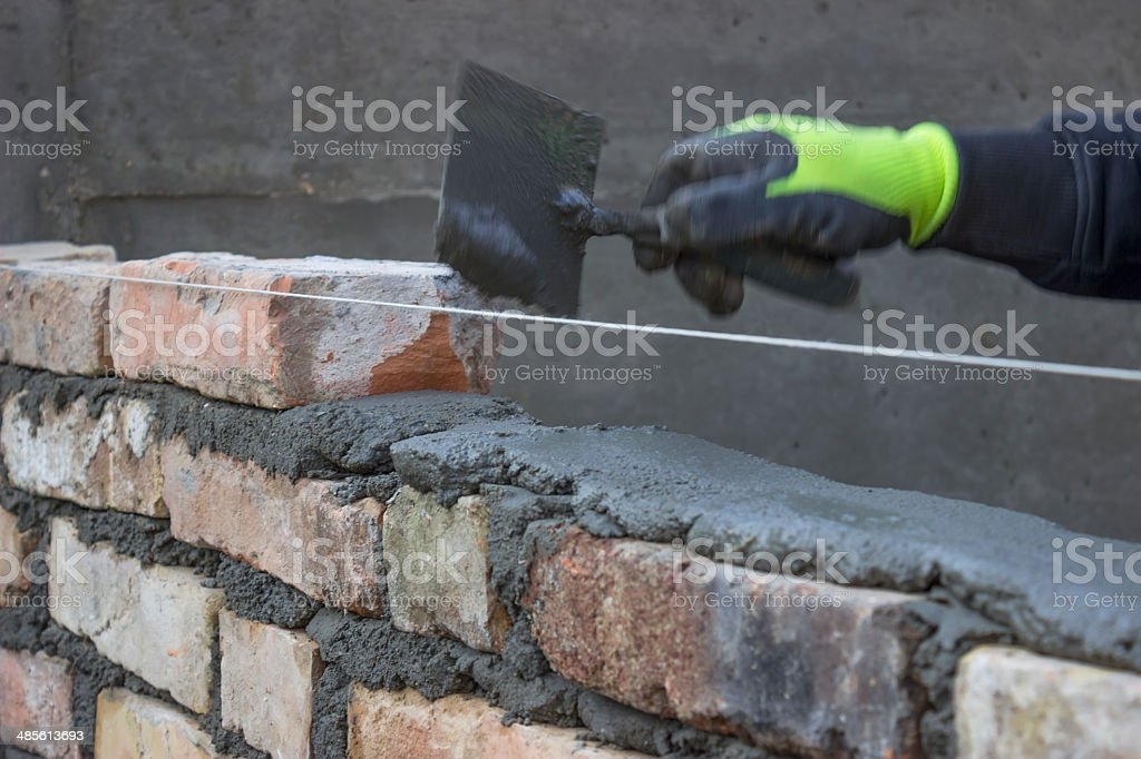 Build A Brick Wall Bricklaying Spreading A Bed Joint 2 stock photo ...