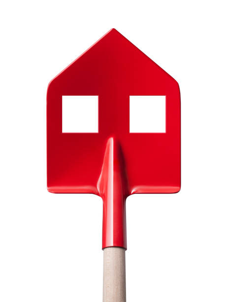 Build a house. Shovel in the shape of a house on white background. - foto stock