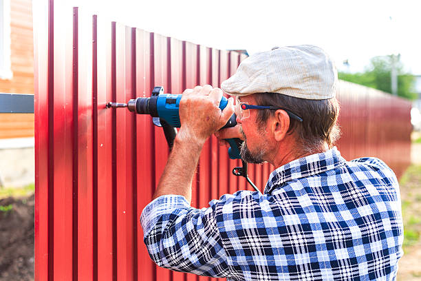 build a metal fence - fence stock photos and pictures