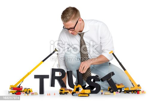 939533958 istock photo Build up trust: Businessman building trust-word. 163257974