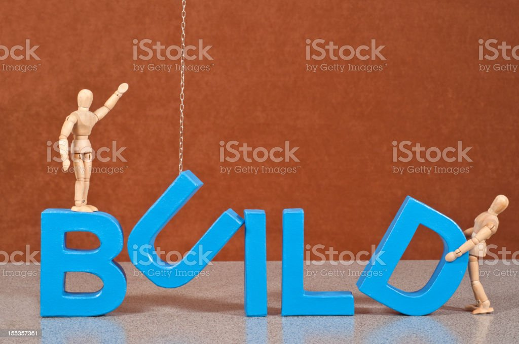 Build - Wooden Mannequin demonstrating this word stock photo
