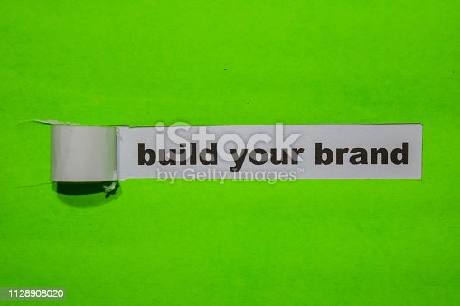 874270826istockphoto Build Your Brand, Inspiration and business concept on green torn paper 1128908020