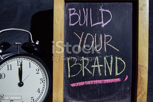 istock Build your brand on phrase colorful handwritten on blackboard. 1037090930