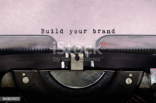 874270826istockphoto Build your brand typed on a vintage typewriter 840623022