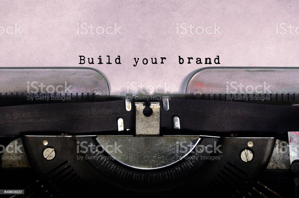 Build your brand typed on a vintage typewriter stock photo