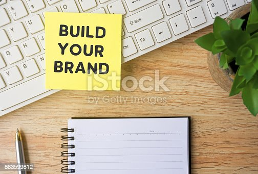 874270826istockphoto Build Your Brand Word on Paper 863599812