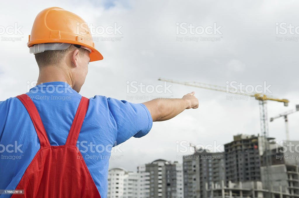 builder and building under construction royalty-free stock photo
