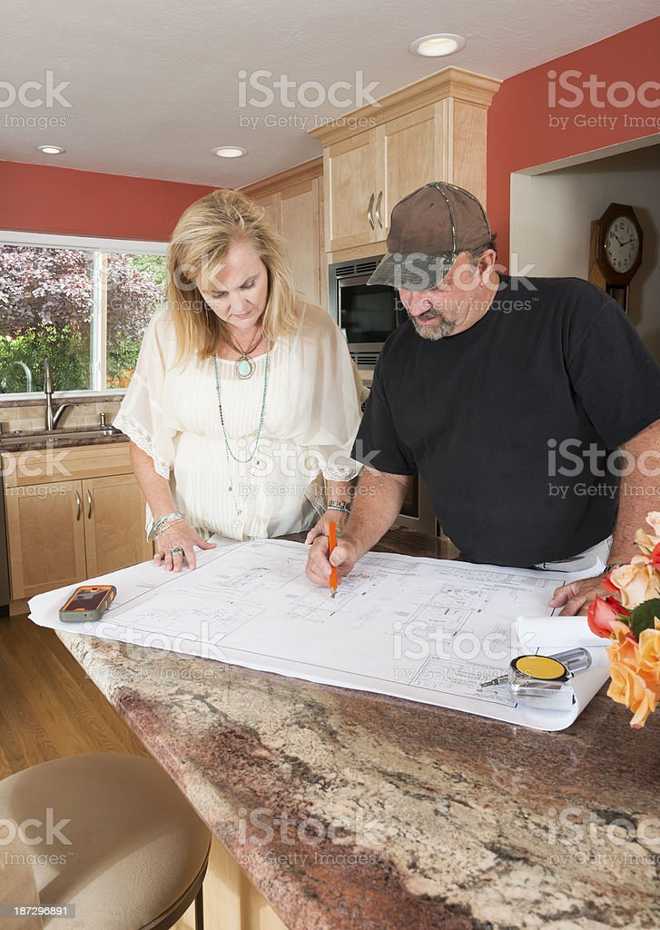 Builder and Client in Remodeled Kitchen royalty-free stock photo