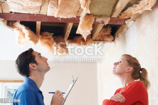istock Builder And Client Inspecting Roof Damage 171572856