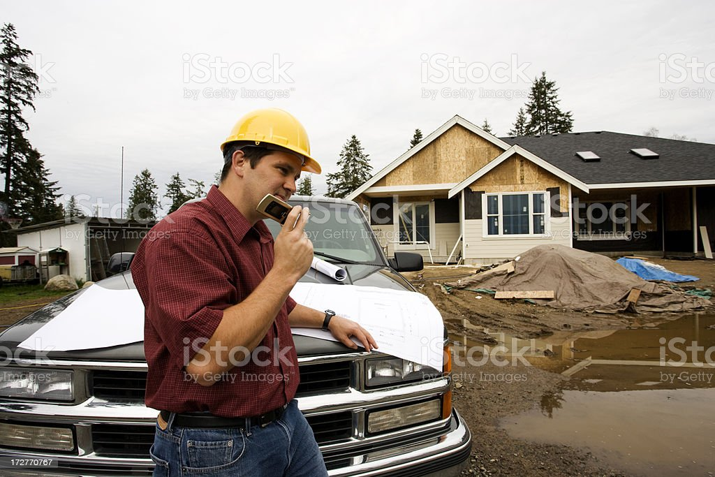 builder and plans royalty-free stock photo