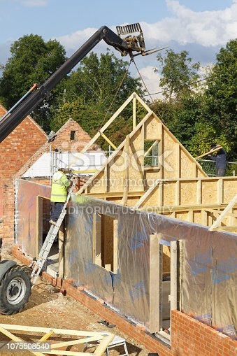 534196421 istock photo Builder at work on a building site 1075508540