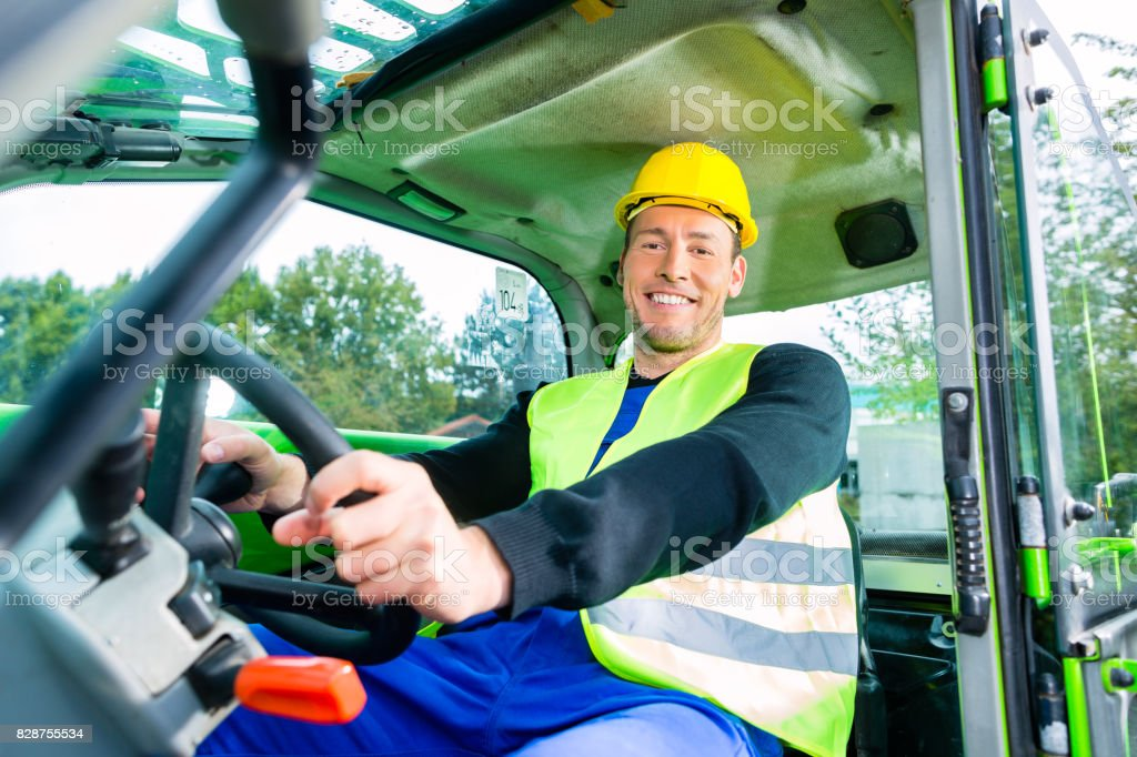 Builder driving construction machinery stock photo
