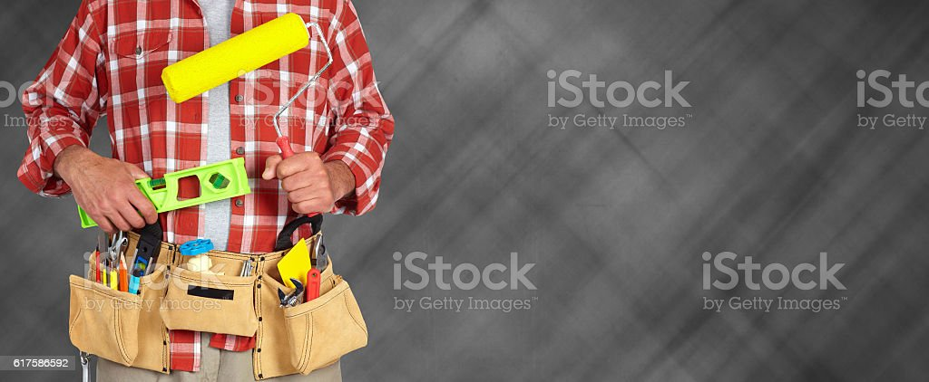 Builder handyman with paint roller. – Foto