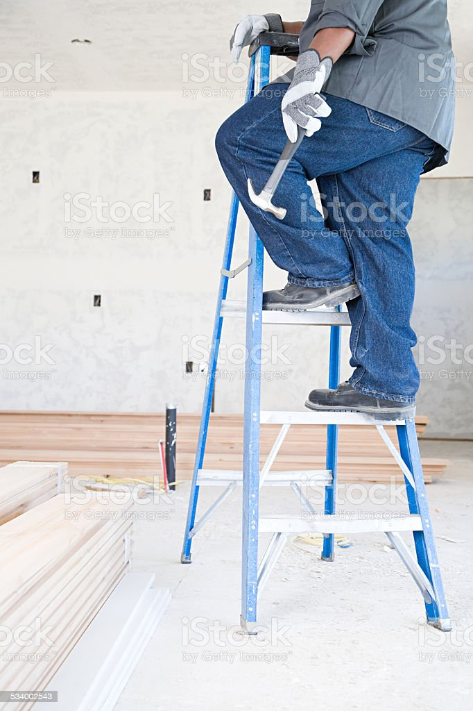 Builder holding a hammer stock photo
