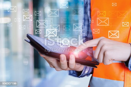 istock Builder is working on tablet with the mail . 936307196