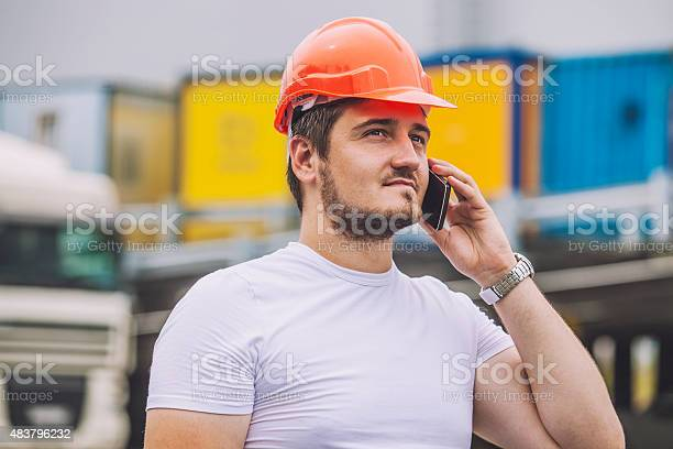 Builder man working with a cell phone in a protective picture id483796232?b=1&k=6&m=483796232&s=612x612&h=o 6pmwhdbjz i1cb1cv jrizx4oaelnjyzsyiq1umfu=