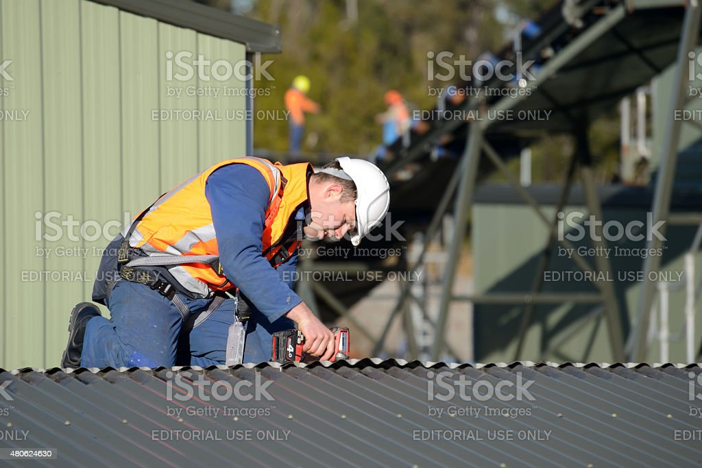builder on the roof stock photo