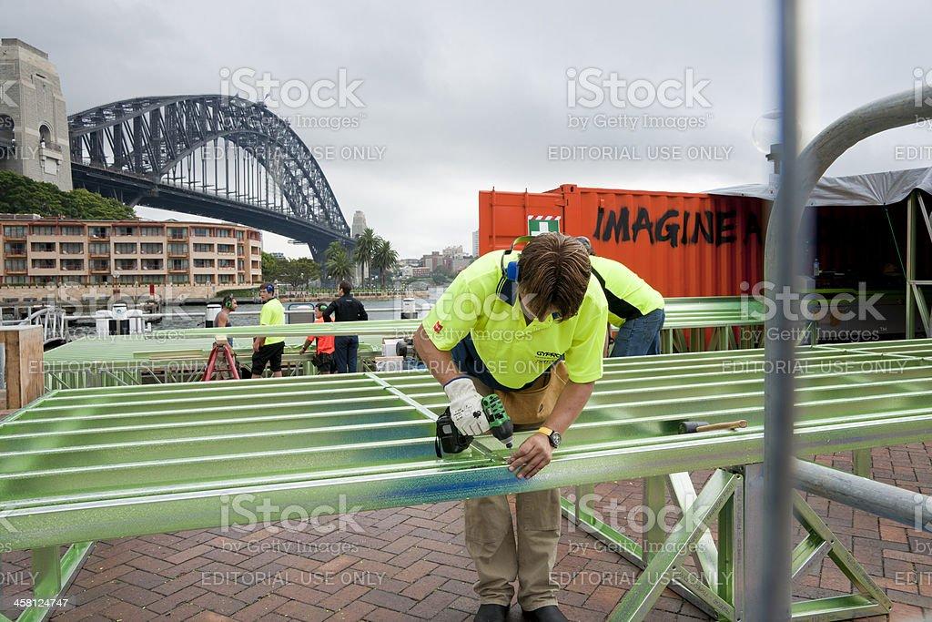 Builder on waterfront, under Sydney Harbour Bridge. royalty-free stock photo