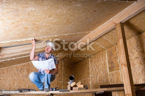 istock Builder Reading Plans Inside Unfinished Home 522476678