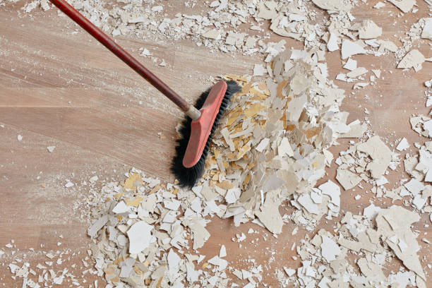 builder sweeping the floor after renovation - sweeping stock pictures, royalty-free photos & images