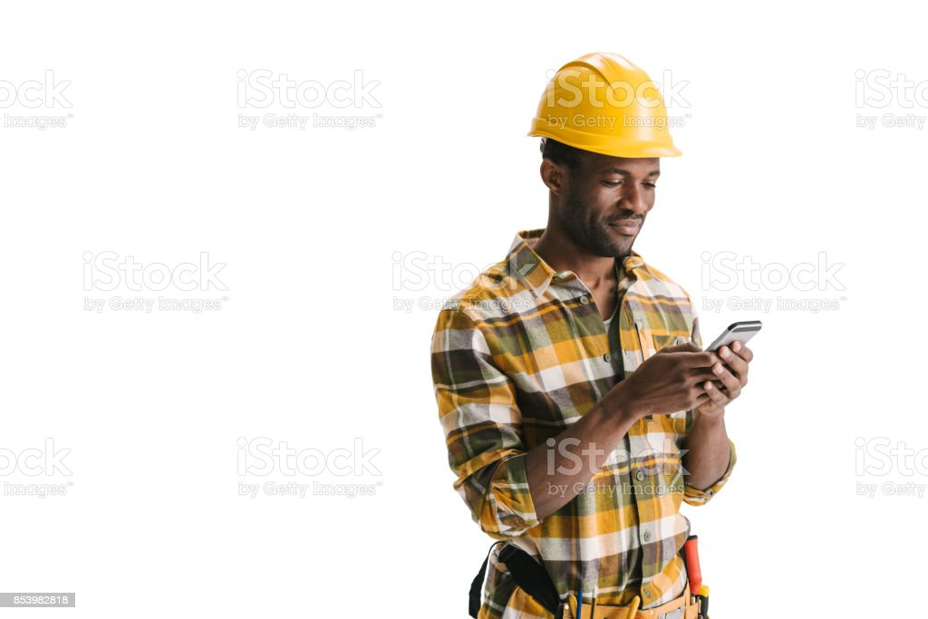 builder texting messege on smartphone stock photo