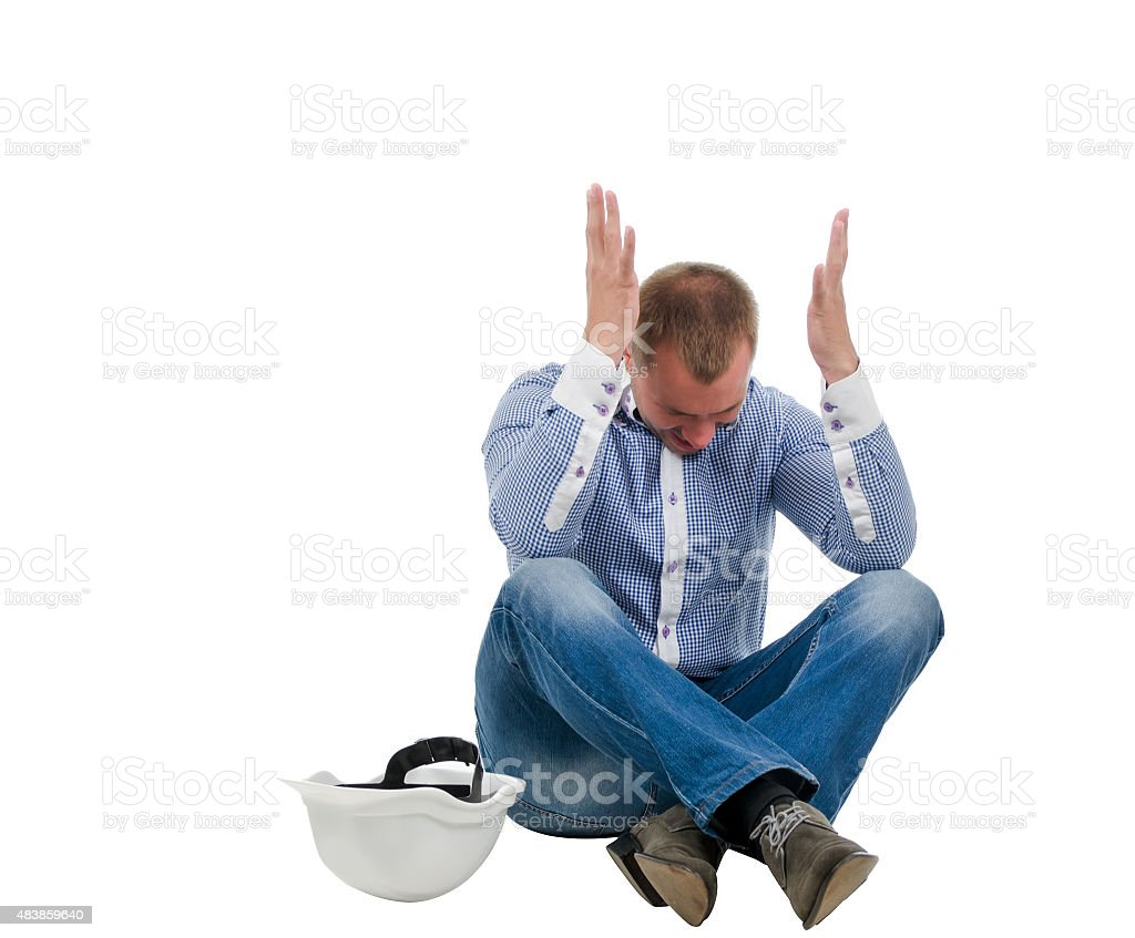 Builder throwing up his hands in disgust stock photo