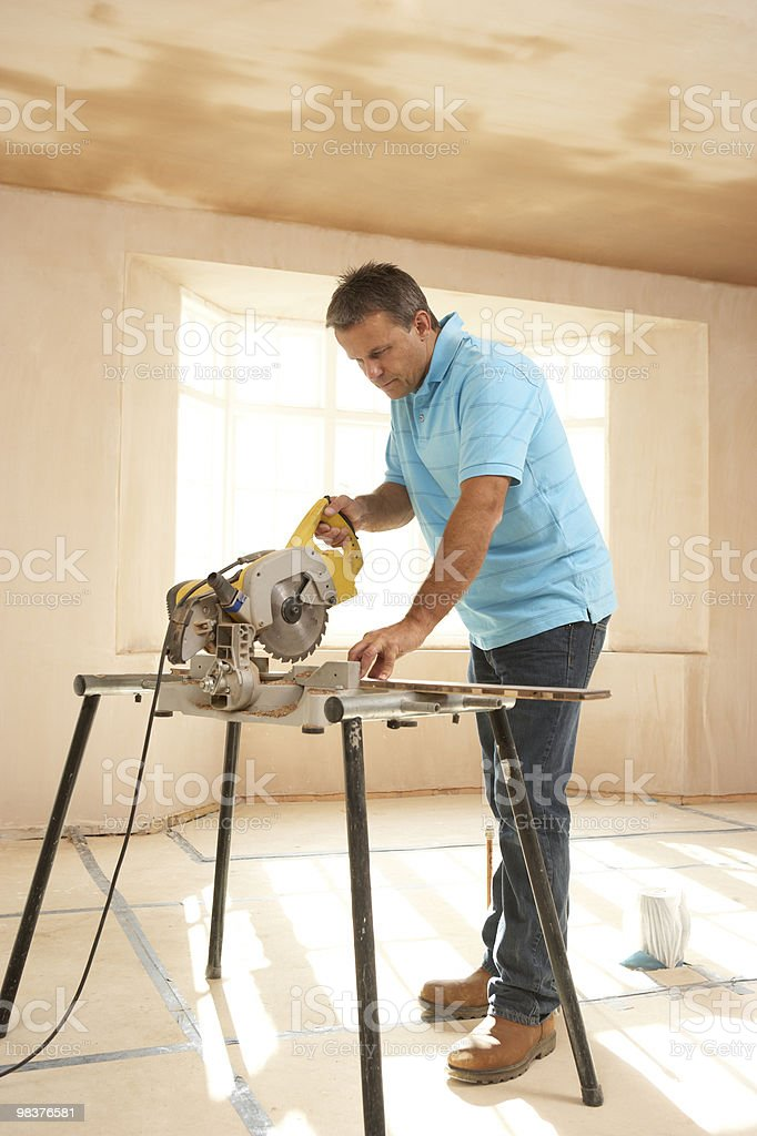 Builder Using Electric Saw royalty-free stock photo