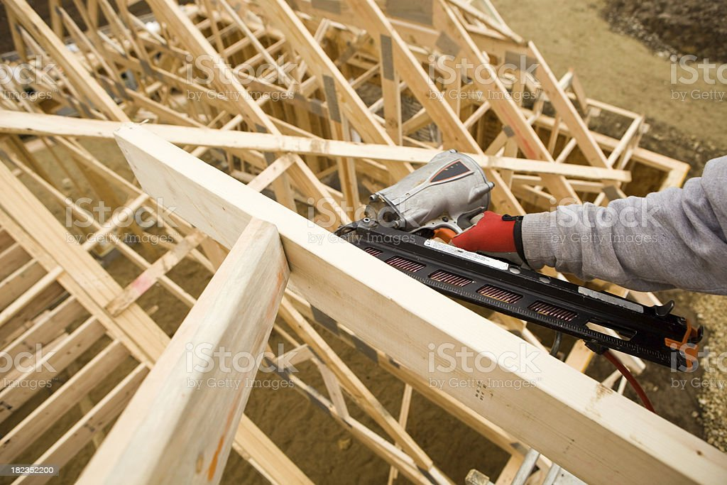 Builder Using Pneumatic Framing Nailer To Secure Roof Truss Stock ...