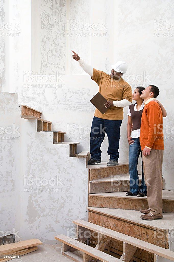 Builder with a man and woman stock photo