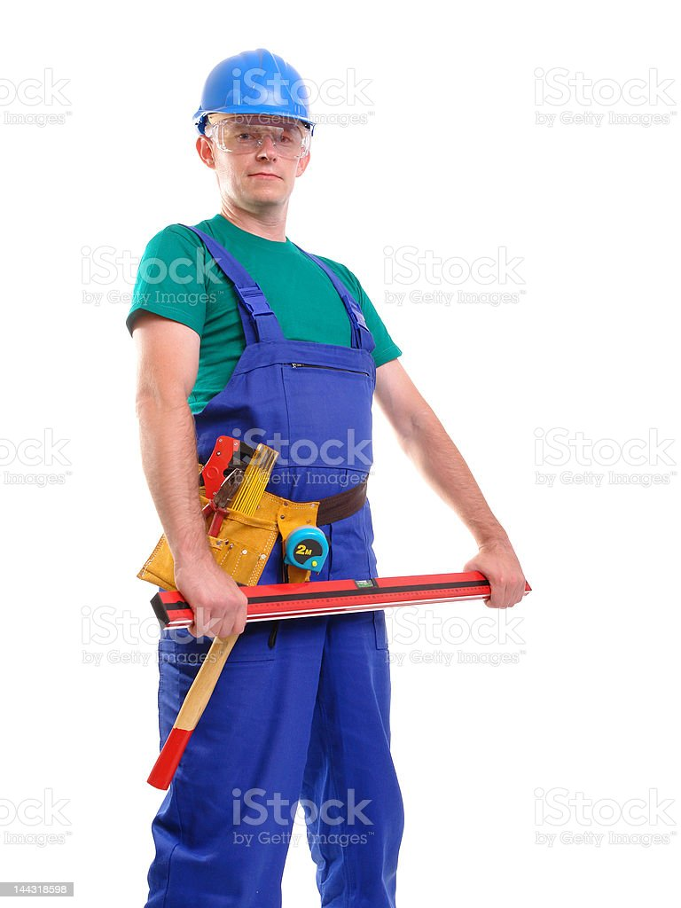 Builder with level royalty-free stock photo