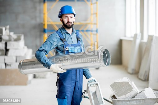 895571294 istock photo Builder with pipe indoors 938084354